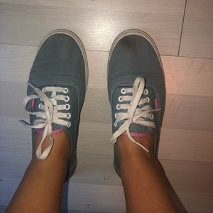 Gray and pink Vans shoes